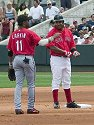 Manny Ramirez says hello to Cincinnati´s Barry Larkin after hitting a double, Red Sox spring training, Fort Myers, Florida, 2003.