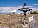 This small dish is used for a visitor center demonstration, National Radio Astronomy Observatory near Socorro, New Mexico, 2004.  Note the sign.