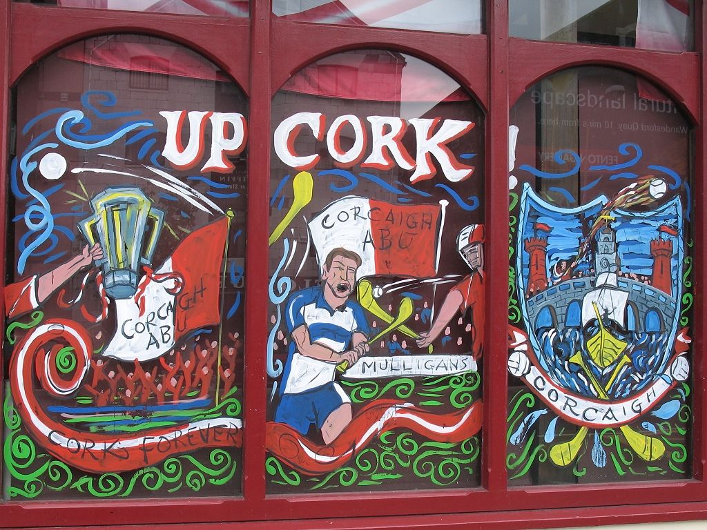 Cork pub painted its windows in support of the local hurling club playing in the All-Ireland championship that weekend, Ireland 2005.  Click for next photo.