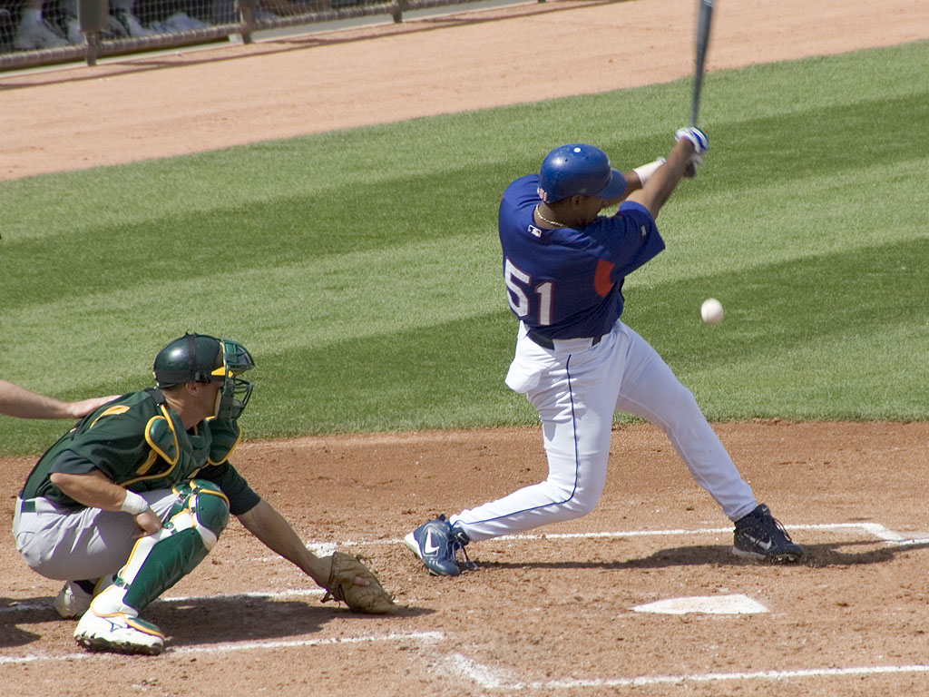 Richard Hidalgo of the Rangers fouls one off, spring 2005.  Click for next photo.