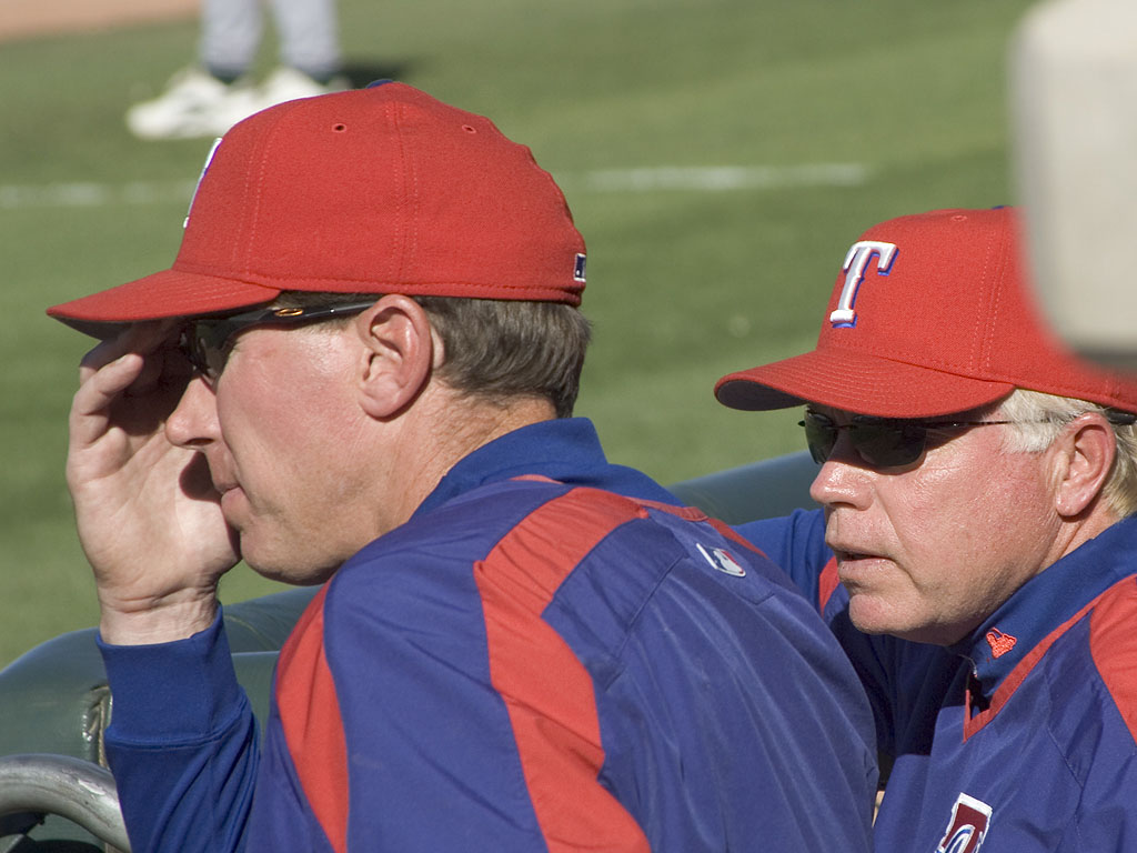 Rangers pitching coach Orel Hershiser and manager Buck Showalter keep an eye on the mound staff, spring 2005.  Click for next photo.
