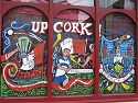 Cork pub painted its windows in support of the local hurling club playing in the All-Ireland championship that weekend, Ireland 2005.