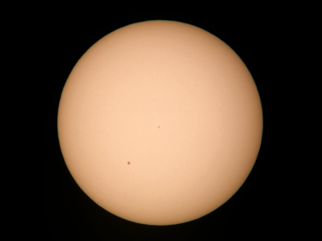 Sun with a few spots, June 2006, glass solar filter.  Click for next photo.