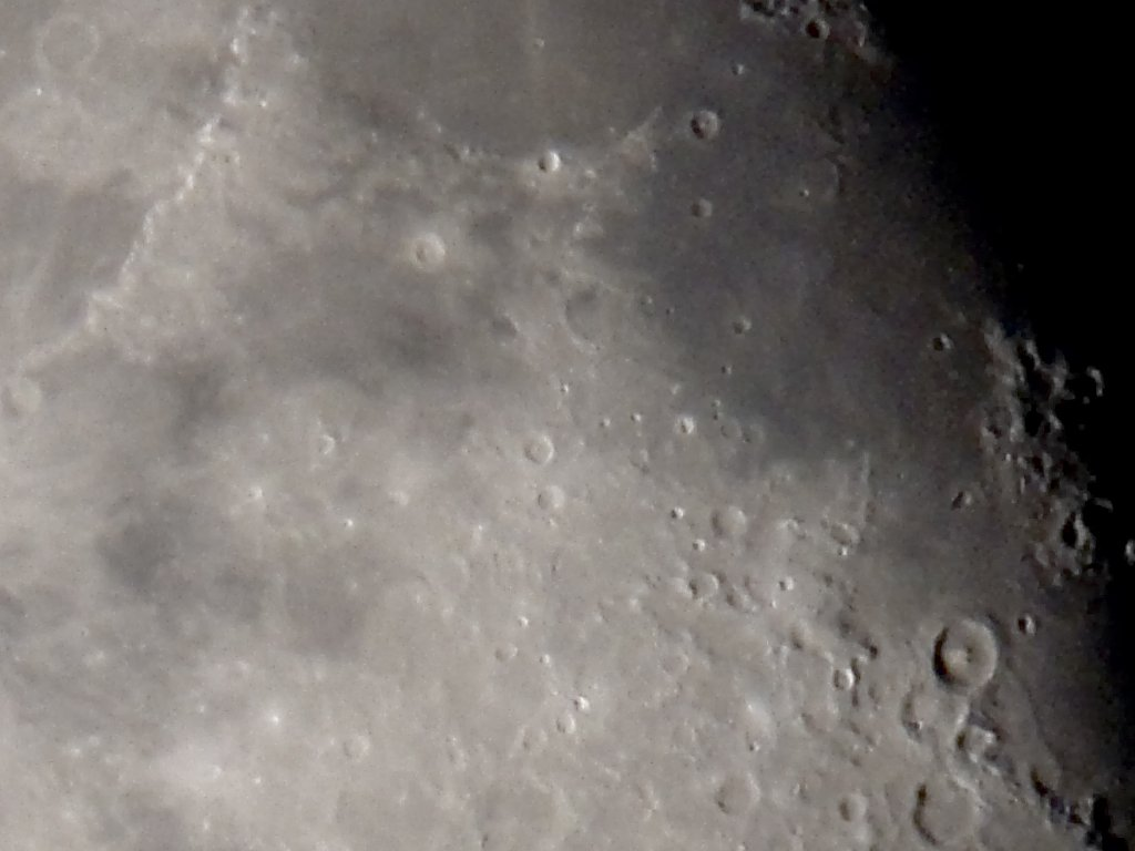Digiscoping the waning Moon, July 2006, Canon G6 and Televue 85.  Detail of previous image showing the 100 km crater Theophilus (with the obvious center peak) lower right and part of the Montes Apenninus mountains upper left.  Click for next photo.