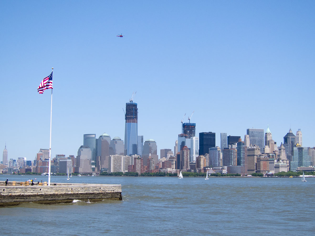 Flag on Ellis Island looking toward lower Manhattan, New York, May 2012.  Click for next photo.