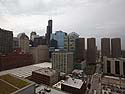 View from the Chicago apartment building I lived in 2011-2013.  This is from the rooftop looking south down Jefferson St.  The Willis Tower towers over its neighbors.  At right, the four buildings in a row are the Presidential Towers (apartments).  Photo taken October 2012.