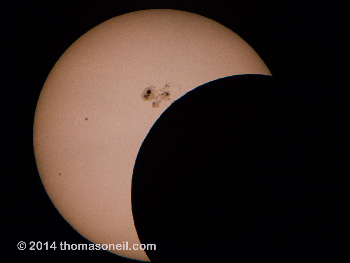 Partial solar eclipse, October 23, 2014.  Last good shot I got before the clouds got in the way.  Click for next photo.
