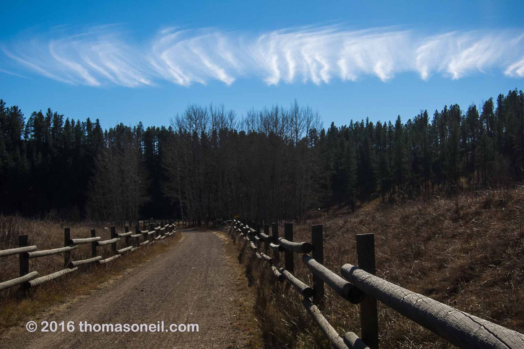 Weird cloud formations, along the Mickelson Trail north of Hill City, 2016.  Click for next photo.