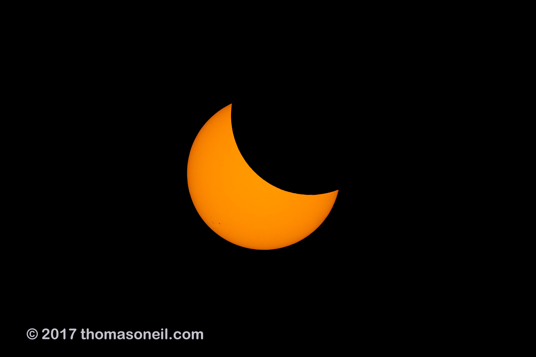 Solar eclipse, Aug. 21, 2017, the Moon is starting to cover a line of sunspots.  Click for next photo.